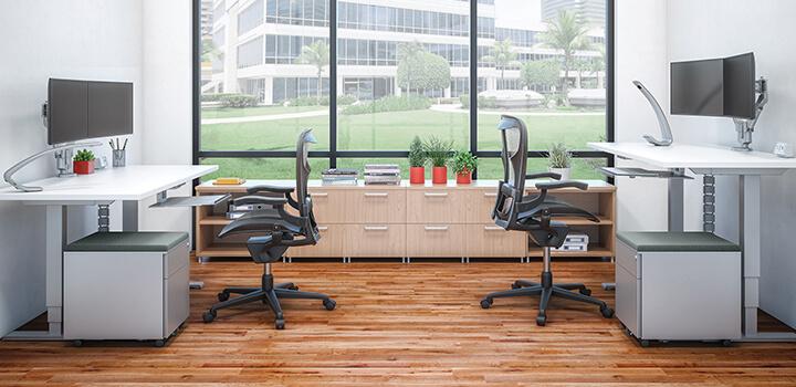 Standing Desks: Height Adjustable Desks or Desk Risers?